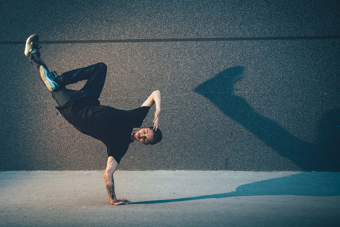 BBoy dancing and doing handstand on street